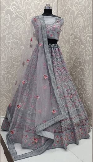 This Wedding Season, Look The Most Graceful Of All Wearing This Heavy Designer Lehenga Choli In Grey Color. Its Blouse, Lehenga And Dupatta are Fabricated on Net Beautified With Tone To Tone Coding Work And Contrasting Resham Embroidery With Stone Work. Buy Now.