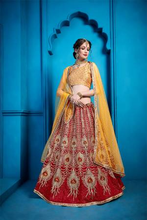 Go Colorful With This Very Beautiful Heavy Designer Lehenga Choli In Golden Colored Blouse Paired With Red Colored Lehenga And Musturd Yellow Colored Dupatta. This Lehenga Choli Is Silk Based Paired With Net Fabricated Dupatta.