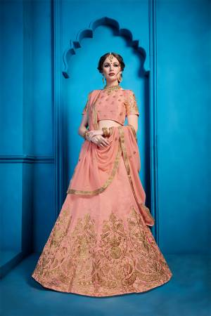 You Will Definitely Earn Lots Of Compliments Wearing This Heavy Designer Lehenga Choli In Dusty Peach Color. This Pretty Detailed Embroidered Lehenga Choli Is Silk Based Paired With Georgette Fabricated Dupatta. Buy Now.