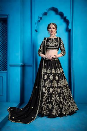 For A Bold And Beautiful Look, Grab This Attractive Looking Heavy Embroidered Designer Lehenga Choli In All Over Black Color. This Lehenga Choli Is Silk Based Paired With Net Fabricated Dupatta. Buy Now.