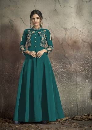 Here Is A Solution For Your Party Wear Dresses With This Designer?Readymade Gown In Teal Blue Color Fabricated On Tafeta Art Silk. It Has Very Beautiful Pattern With Detailed Embroidery And Available In All Regular Sizes. Buy Now.