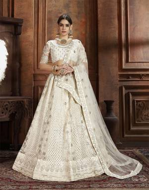 Flaunt Your Rich And Elegant Taste Wearing This Heavy Designer Lehenga Choli In White Color. This Beautifully Embroidered Heavy Lehenga Choli And Its Dupatta Are Fabricated On Net. Its Elegant Color And Detailed Embroidery Will Earn You Lots Of Compliments From Onlookers.