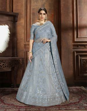 Get Ready For The Upcoming Wedding Season With This Very Beautiful Heavy Designer Lehenga Choli In Powder Blue Color. Its Heavy Embroidered Blouse, Lehenga And Choli Are Fabricated On Net Which Is Light In Weight And Easy To Carry Throughout The Gala.