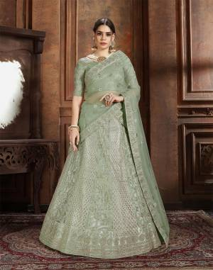 Flaunt Your Rich And Elegant Taste Wearing This Heavy Designer Lehenga Choli In Mint Green Color. This Beautifully Embroidered Heavy Lehenga Choli And Its Dupatta Are Fabricated On Net. Its Elegant Color And Detailed Embroidery Will Earn You Lots Of Compliments From Onlookers.