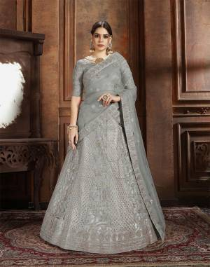 Here Is Very Elegant Looking Heavy Designer Lehenga Choli For The Upcoming Wedding Season In Pretty Grey Color. This Lehenga , Choli And Dupatta Are Fabricated On Net Beautified With Heavy Detailed Embroidery. Buy Now.