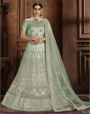 Get Ready For The Upcoming Wedding Season With This Very Beautiful Heavy Designer Lehenga Choli In Pastel Green Color. Its Heavy Embroidered Blouse, Lehenga And Choli Are Fabricated On Net Which Is Light In Weight And Easy To Carry Throughout The Gala.