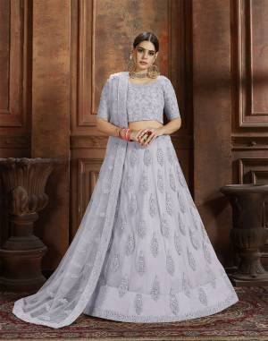 Beautiful And Elegant Looking Shade Is Here To Add Into Your Wardrobe With This Heavy Designer Lehenga Choli In Grey Color. This Lehenga Choli And Dupatta Are Fabricated On Net Beautified With Heavy Detailed Embroidery. Buy Now.