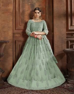Beautiful And Elegant Looking Shade Is Here To Add Into Your Wardrobe With This Heavy Designer Lehenga Choli In Pastel Green Color. This Lehenga Choli And Dupatta Are Fabricated On Net Beautified With Heavy Detailed Embroidery. Buy Now.