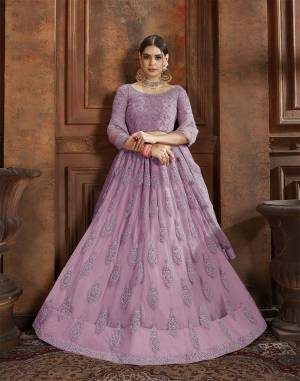 Flaunt Your Rich And Elegant Taste Wearing This Heavy Designer Lehenga Choli In Lilac Color. This Beautifully Embroidered Heavy Lehenga Choli And Its Dupatta Are Fabricated On Net. Its Elegant Color And Detailed Embroidery Will Earn You Lots Of Compliments From Onlookers.