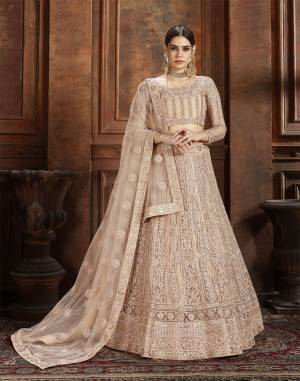 Here Is Very Elegant Looking Heavy Designer Lehenga Choli For The Upcoming Wedding Season In Pretty Beige. This Lehenga , Choli And Dupatta Are Fabricated On Net Beautified With Heavy Detailed Embroidery. Buy Now.