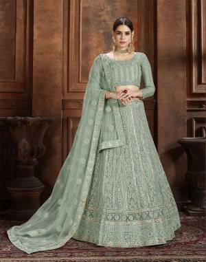 Get Ready For The Upcoming Wedding Season With This Very Beautiful Heavy Designer Lehenga Choli In Mint Green Color. Its Heavy Embroidered Blouse, Lehenga And Choli Are Fabricated On Net Which Is Light In Weight And Easy To Carry Throughout The Gala.