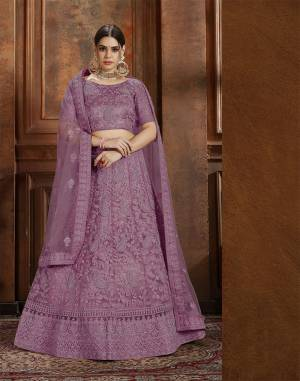 Flaunt Your Rich And Elegant Taste Wearing This Heavy Designer Lehenga Choli In Lavendor Color. This Beautifully Embroidered Heavy Lehenga Choli And Its Dupatta Are Fabricated On Net. Its Elegant Color And Detailed Embroidery Will Earn You Lots Of Compliments From Onlookers.