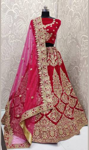 Here Is A Beautiful Designer Bridal Lehenga Choli In Rani Pink Color. This Beautiful Heavy Lehenga Choli Is Fabricated On Velvet Paired With Net Fabricated Dupatta. It Is Beautified With Heavy Detailed Embroidery. Get Ready For Your D-Day With This Designer Piece And Look The Most Graceful Of All.