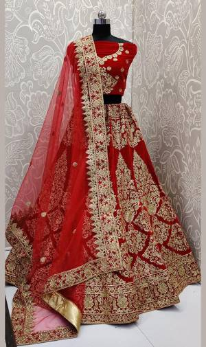 Here Is A Beautiful Designer Bridal Lehenga Choli In Red Color. This Beautiful Heavy Lehenga Choli Is Fabricated On Velvet Paired With Net Fabricated Dupatta. It Is Beautified With Heavy Detailed Embroidery. Get Ready For Your D-Day With This Designer Piece And Look The Most Graceful Of All.