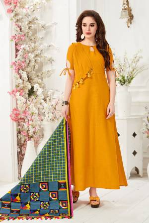Here Is A Pretty Readymade Gown In Musturd Yellow Color Paired With Blue And Multi Colored Dupatta. This Pretty Gown Is Fabricated On Cotton Slub Paired With Chanderi Cotton Fabricated Dupatta Beautified With Digital Prints.