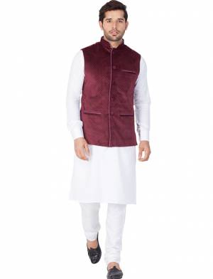 Here Is A Rich And Decent Looking Readymade Pair Of Men's Kurta Pyjama In White Color Paired With Wine Colored Jacket. This Kurta And Pyjama Are Fabricated On Cotton Paired With Velvet Fabricated Jacket. Buy This Pair For The Upcoming Wedding And Festive Season.