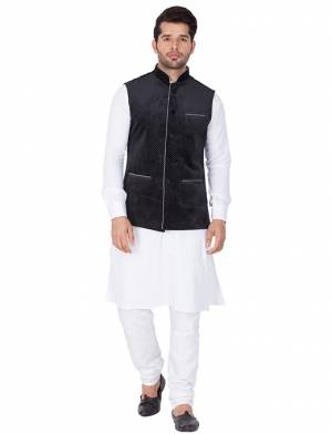 Here Is A Rich And Decent Looking Readymade Pair Of Men's Kurta Pyjama In White Color Paired With Black Colored Jacket. This Kurta And Pyjama Are Fabricated On Cotton Paired With Velvet Fabricated Jacket. Buy This Pair For The Upcoming Wedding And Festive Season.