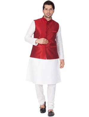 Here Is A Rich And Decent Looking Readymade Pair Of Men's Kurta Pyjama In White Color Paired With Red Colored Jacket. This Kurta And Pyjama Are Fabricated On Cotton Silk Paired With Art Silk Fabricated Jacket. Buy This Pair For The Upcoming Wedding And Festive Season.