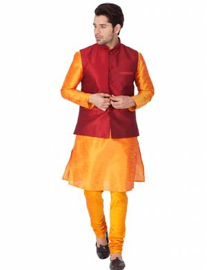 Here Is A Rich And Decent Looking Readymade Pair Of Men's Kurta Pyjama In Orange Color Paired With Red Colored Jacket. This Kurta And Pyjama Are Fabricated On Cotton Silk Paired With Art Silk Fabricated Jacket. Buy This Pair For The Upcoming Wedding And Festive Season.