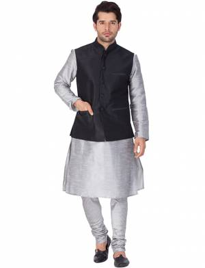 Here Is A Rich And Decent Looking Readymade Pair Of Men's Kurta Pyjama In Grey Color Paired With Black Colored Jacket. This Kurta And Pyjama Are Fabricated On Cotton Silk Paired With Art Silk Fabricated Jacket. Buy This Pair For The Upcoming Wedding And Festive Season.