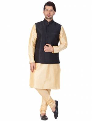 Here Is A Rich And Decent Looking Readymade Pair Of Men's Kurta Pyjama In Cream Color Paired With Black Colored Jacket. This Kurta And Pyjama Are Fabricated On Cotton Silk Paired With Art Silk Fabricated Jacket. Buy This Pair For The Upcoming Wedding And Festive Season.