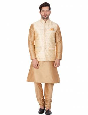 Here Is A Rich And Decent Looking Readymade Pair Of Men's Kurta Pyjama In Beige Color Paired With Cream Colored Jacket. This Kurta And Pyjama Are Fabricated On Cotton Silk Paired With Jacquard Silk Fabricated Jacket. Buy This Pair For The Upcoming Wedding And Festive Season.