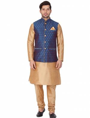 Here Is A Rich And Decent Looking Readymade Pair Of Men's Kurta Pyjama In Beige Color Paired With Royal Blue Colored Jacket. This Kurta And Pyjama Are Fabricated On Cotton Silk Paired With Jacquard Silk Fabricated Jacket. Buy This Pair For The Upcoming Wedding And Festive Season.