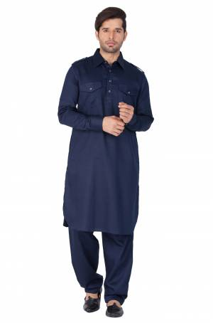 Get Ready For The Upcoming Festive Season With This Readymade Pair Of Pathani Kurta Pyjama For Men's Wear. This Rich Navy Blue Colored Pair Is Fabricated On Cotton Which Is Light Weight, Soft Towards Skin And Available In All Sizes. Buy Now.