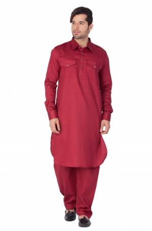 Get Ready For The Upcoming Festive Season With This Readymade Pair Of Pathani Kurta Pyjama For Men's Wear. This Rich Maroon Colored Pair Is Fabricated On Cotton Which Is Light Weight, Soft Towards Skin And Available In All Sizes. Buy Now.