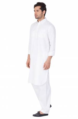 Get Ready For The Upcoming Festive Season With This Readymade Pair Of Pathani Kurta Pyjama For Men's Wear. This Rich White Colored Pair Is Fabricated On Cotton Which Is Light Weight, Soft Towards Skin And Available In All Sizes. Buy Now.