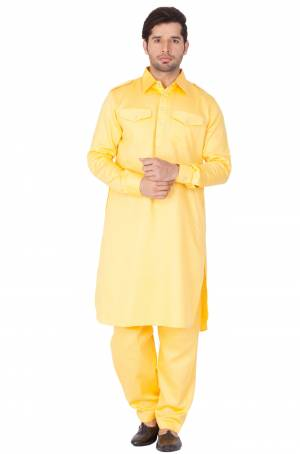 Get Ready For The Upcoming Festive Season With This Readymade Pair Of Pathani Kurta Pyjama For Men's Wear. This Rich Yellow Colored Pair Is Fabricated On Cotton Which Is Light Weight, Soft Towards Skin And Available In All Sizes. Buy Now.