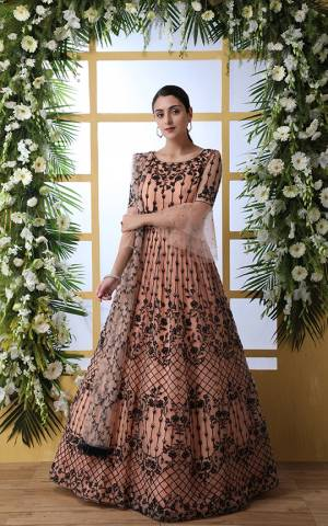 Look Pretty In This Designer Floor Length Gown In Peach Color Paired With Peach Colored Dupatta. Its Heavy Embroidered Top Is Fabricated On Net Paired With Net fabricated Dupatta. Buy This Semi-Stitched Designer Gown Now.