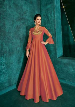 Celebrate This Festive Season Wearing This Designer Readymade Gown In Rust Orange Color Fabricated On Soft Art Silk Beautified With Embroidery. Its Rich Fabric And Color Will Definitely Earn You Lots Of Compliments From Onlookers.
