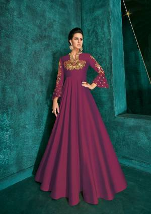Celebrate This Festive Season Wearing This Designer Readymade Gown In Magenta Pink Color Fabricated On Soft Art Silk Beautified With Embroidery. Its Rich Fabric And Color Will Definitely Earn You Lots Of Compliments From Onlookers.