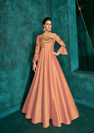 Celebrate This Festive Season Wearing This Designer Readymade Gown In Peach Color Fabricated On Soft Art Silk Beautified With Embroidery. Its Rich Fabric And Color Will Definitely Earn You Lots Of Compliments From Onlookers.