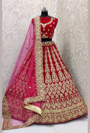 Here Is A Very Beautiful and Heavy Bridal Lehenga Choli In All over Rani Pink Color. This Lehenga Choli Is Fabricated on Velvet Paired With Net Fabricated Dupatta. It Is Beautified With Heavy Embroidery Which Will Earn You Lots of Compliments From Onlookers.