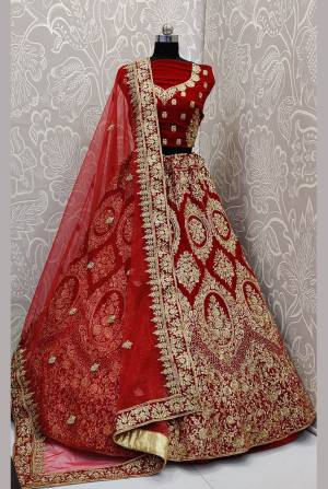 Here Is A Very Beautiful and Heavy Bridal Lehenga Choli In All over Red Color. This Lehenga Choli Is Fabricated on Velvet Paired With Net Fabricated Dupatta. It Is Beautified With Heavy Embroidery Which Will Earn You Lots of Compliments From Onlookers.
