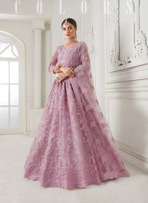 Look Ravishing Wearing This Heavy Deisgner Lehenga Choli In All Over Baby Pink Color. Its Detailed Embroidered Blouse, Lehenga And Dupatta Are Fabricated Net Beautified With Elegant Tone To Tone Resham And Coding Work Highlited With Stones. Buy This Heavy Yet Subtle Look Designer Lehenga Choli Now.