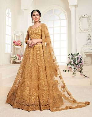 Get Ready For The Upcoming Wedding Season Wearing This Lovely Tone To Tone Heavy Embroidered Lehenga Choli In Occur Yellow Color. Its Blouse, Lehenga And Dupatta Are Fabricated On Net Which Comes With Same Colored Satin Silk Inner. Pair This Up With Delicate Pearl Accessories for A Look Like Never Before.