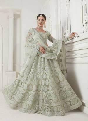 Look Ravishing Wearing This Heavy Deisgner Lehenga Choli In All Over Pastel Pink Color. Its Detailed Embroidered Blouse, Lehenga And Dupatta Are Fabricated Net Beautified With Elegant Tone To Tone Resham And Coding Work Highlited With Stones. Buy This Heavy Yet Subtle Look Designer Lehenga Choli Now.