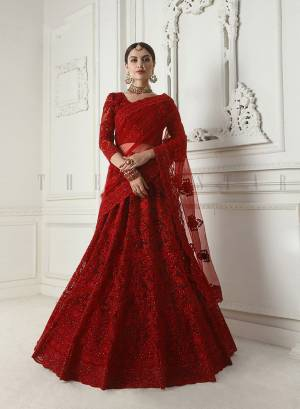 Look Ravishing Wearing This Heavy Deisgner Lehenga Choli In All Over Red Color. Its Detailed Embroidered Blouse, Lehenga And Dupatta Are Fabricated Net Beautified With Elegant Tone To Tone Resham And Coding Work Highlited With Stones. Buy This Heavy Yet Subtle Look Designer Lehenga Choli Now.