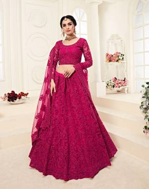 Get Ready For The Upcoming Wedding Season Wearing This Lovely Tone To Tone Heavy Embroidered Lehenga Choli In Rani Pink Color. Its Blouse, Lehenga And Dupatta Are Fabricated On Net Which Comes With Same Colored Satin Silk Inner. Pair This Up With Delicate Pearl Accessories for A Look Like Never Before.