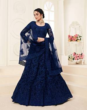 Catch All The Limelight At The Next Wedding You Attend Wearing This Very Attractive And Heavy Designer Lehenga Choli In All Over Royal Blue Color. This Lehenga Choli Is Net Based Paired With Net Fabricated Dupatta. It Is Beautified With Tone to Tone Embroidery Higihted With Stone Work.