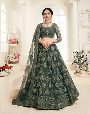 Flaunt Your Rich And Elegant Taste Wearing This Very Pretty Heavy Designer Lehenga Choli In All Over Teal Green Color. This Pretty Lehenga Choli Is Fabricated On Net Paired With Net Fabricated Dupatta. It Is Beautified With Heavy Tone To Tone Embroidery Giving It A Pretty Subtle Yet Heavy Look.