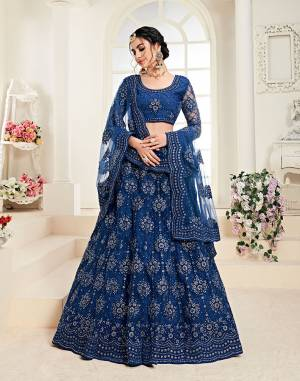 Get Ready For The Upcoming Wedding Season Wearing This Lovely Tone To Tone Heavy Embroidered Lehenga Choli In Royal Blue Color. Its Blouse, Lehenga And Dupatta Are Fabricated On Net Which Comes With Same Colored Satin Silk Inner. Pair This Up With Delicate Pearl Accessories for A Look Like Never Before.