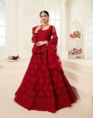 Catch All The Limelight At The Next Wedding You Attend Wearing This Very Attractive And Heavy Designer Lehenga Choli In All Over Red Color. This Lehenga Choli Is Net Based Paired With Net Fabricated Dupatta. It Is Beautified With Tone to Tone Embroidery Higihted With Stone Work.