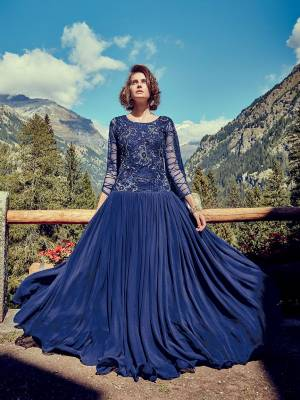 Catch All The Limelight At The Next Wedding You Attend Wearing This Beautiful Heavy Designer Readymade Gown In Royal Blue Color Paired With Royal Blue Colored Dupatta. This Lovely Gown IS Georgette Based With Attractive Net Fabricated Embroidered Yoke And Sleeve Paired With Chiffon Fabricated Dupatta.