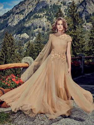 Flaunt Your Rich And Elegant Taste Wearing This Designer Readymade Gown In All Over Beige Color. This Pretty Attractive Gown Is Fabricated Shimmer Net Beautified With Hand Work Paired With Shimmer Net Fabricated Dupatta. Buy Now.