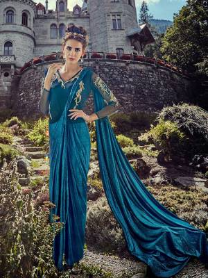 Grab This Very Pretty Readymade Gown Saree In Blue Color. It Is Ready To Wear Saree Like A Gown Which Has Attatched Blouse And Pallu. This Pretty Piece Is Lycra Based Which Is Comfortable to Carry Throughout The Gala.