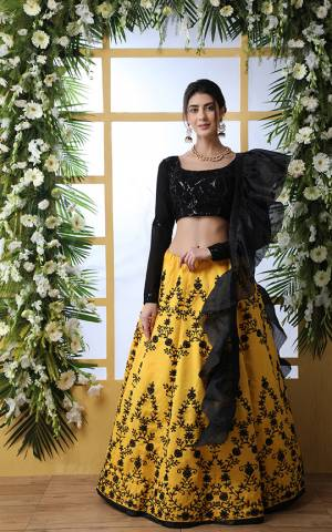 Grab This Bold And Beautiful Look Designer Lehenga Choli In Black Colored Blouse Paired With Yellow Colored Lehenga And Black Dupatta. Its Pretty Blouse Is Georgette Based Paired With Art Silk Lehenga And Orgenza Fabricated Dupatta.